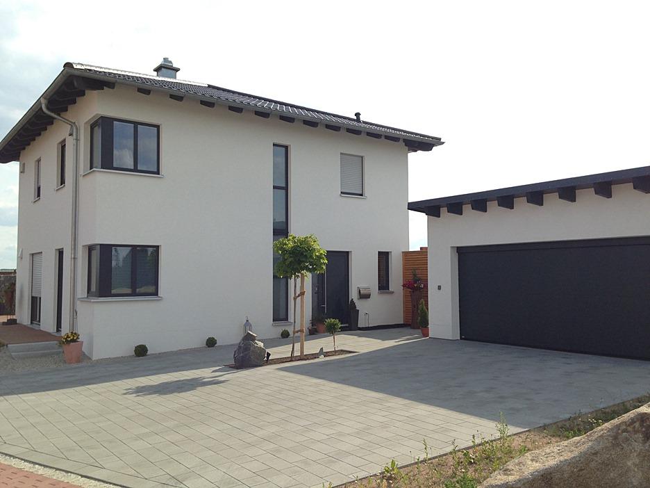 Massivhaus mit doppelgarage  Exclusiv Massivhaus GmbH